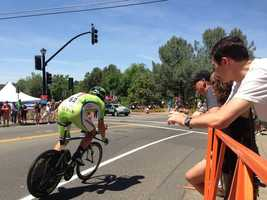Riders speed by the crowd during Stage 2 of the Amgen Tour of California in Folsom. (May 12, 2014)