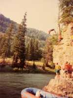 3.) I love to cliff jump. This is a picture of me back-flipping off a cliff along the Snake River many years ago.