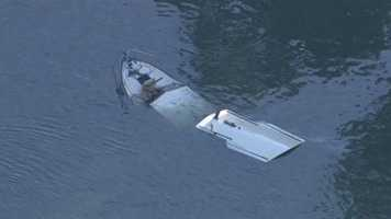 Rescue crews located a sinking boat underneath the I Street Bridge Wednesday morning.