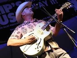 Deke Dickerson plays guitar with his band at the Sacramento Music Festival and Jubilee on May 23.