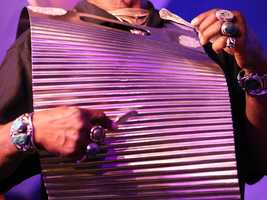 Lloyd Meadows of the Zydeco Flames plays rubboard with his band at the Sacramento Music Festival and Jubilee on May 23.