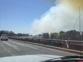 One lane of eastbound Interstate 80 Business is closed at E Street because of smoke drifting on the roadway, according to a California Highway Patrol spokeswoman.