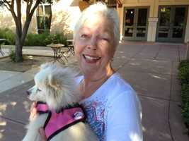 Elizabeth, following the lead of Gov. Brown and Kashkari, brings along her dog Daisy to cast her vote.