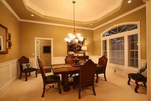 It features five bedrooms, including two master suites, five full baths, a bonus room and office.
