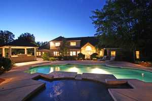 An inviting pool sits on a very private lushly landscaped .71 acre parcel.