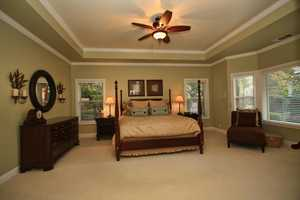 A staircase leads to the second level where you will find the second master suite, Jack and Jill bedrooms and a bathroom.