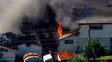Authorities say a three-alarm fire has caused heavy damage to two homes in a Silicon Valley neighborhood.