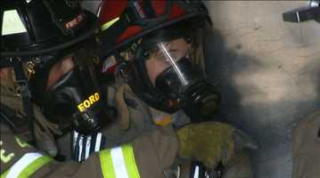 Isabelle Ford gets a few pointers from her dad, who is a Roseville firefighter.