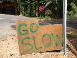 Since putting up the mannequin, neighbors said more motorists seem to be paying attention and slowing down, even though nearly a dozen painted signs were already in place asking drivers to decrease their speed.