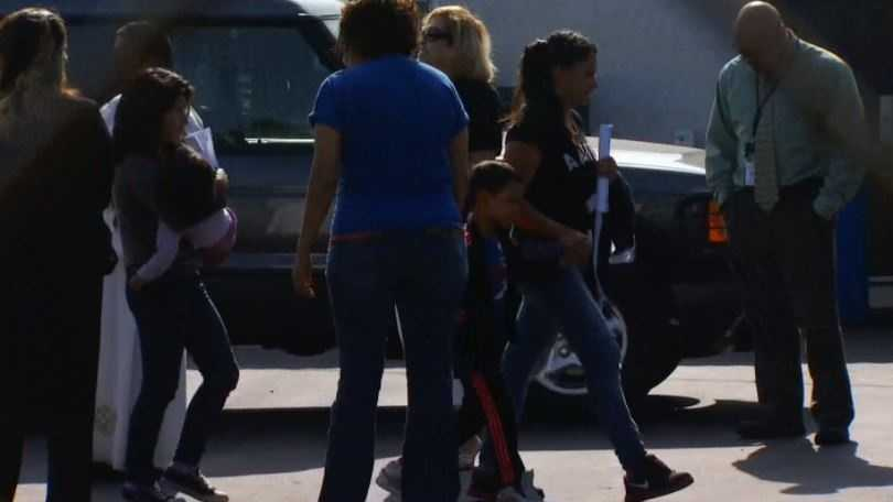 Women and children arrive at a church in San Bernardino County on Thursday.