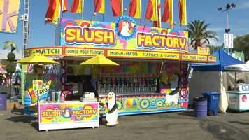 How do you beat the heat at the State Fair? A slushee from the Slush Factory, of course. (July 14, 2014)