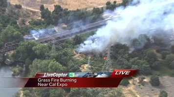 A grass fire burned along the American River Parkway near Cal Expo Tuesday.