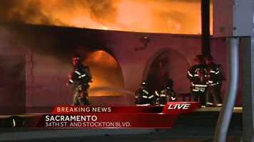 A large fire is engulfing a Sacramento tire shop on Stockton Boulevard.