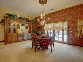 This dining area leads to the backyard, which is just steps away from a swimming pool and guest home.
