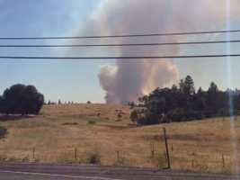 A grass kicked up a massive plume of smoke off Highway 49 in Plymouth. (July 25, 2014)