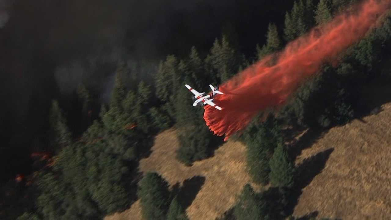 A grass fire burning along the line that separates Amador and El Dorado counties continues to grow Friday night, and is forcing evacuations for people who live along Sand Ridge Road and Freshwater Lane.