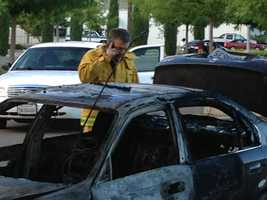 Two charred cars near a Sacramento Regional Transit parking lot are being called suspicious, Sacramento fire officials said Tuesday morning.