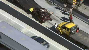 Two people were trapped inside a BMW after a crash on Interstate 80 in Sacramento.