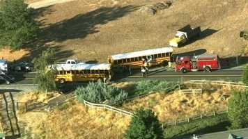 Three people were injured when two vehicles and a bus crashed early Thursday morning, the California Highway Patrol said.