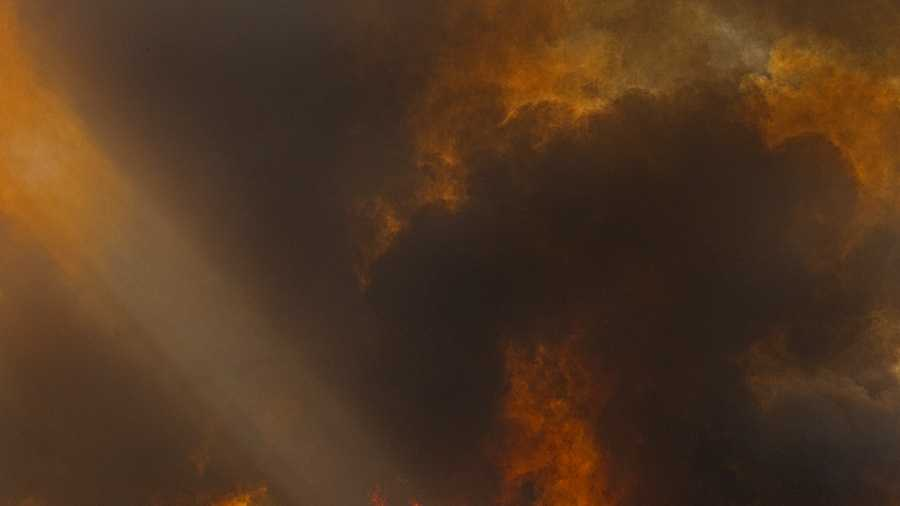 The so-called Junction Fire, which is burning near Yosemite National Park, threatened hundreds of homes on Tuesday. (Aug. 19, 2014)