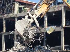 An excavator moves recyclable metal on L Street this week, following the demolition of Downtown Plaza. Metal is the most valuable among the recyclable materials here. Turner Construction estimates that it will remove 4,000 tons of metals from the site by the time demolition is complete -- and the company hopes to recycle all of it.