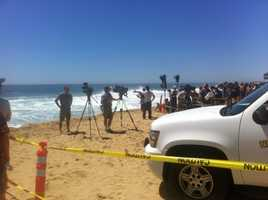 Dozens of people watched surfers catch waves that reached 20-30 feet high at The Wedge in Newport Beach on Thursday.