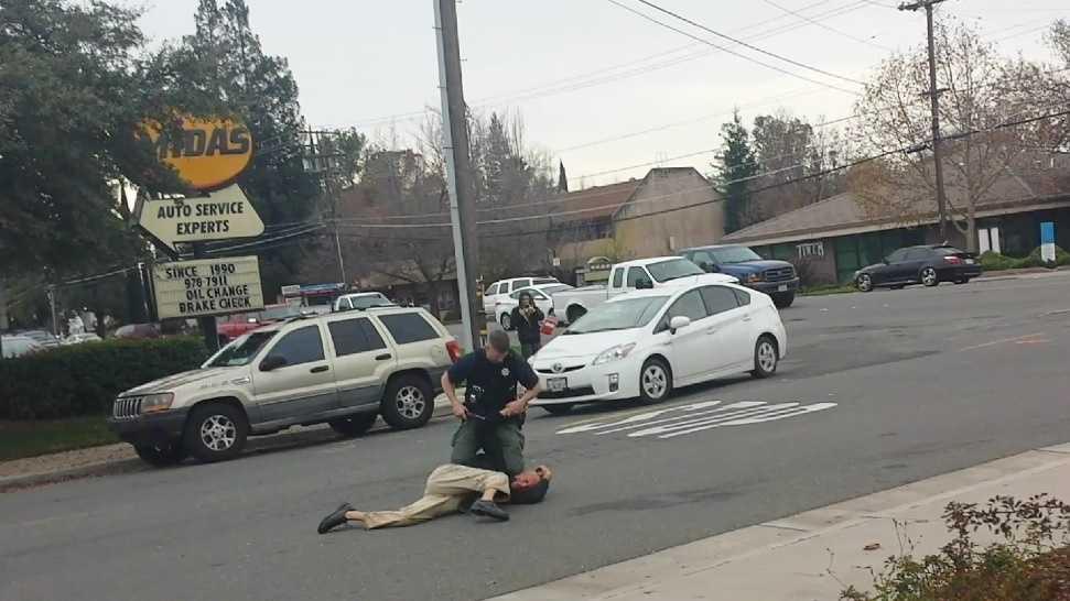 Deputy beating vid 121014.jpg