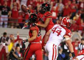 Kyler Reed and Jamal Turner celebrate in the end zone after Reed pulls in a touchdown pass.