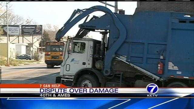 Garbage truck destoys power lines