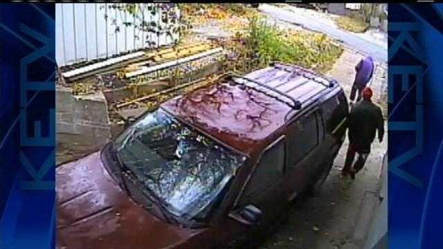 Home surveillance shows robber shoot dog