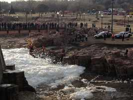 Firefighters and other rescue personnel battled with heavy foam built up along the river.