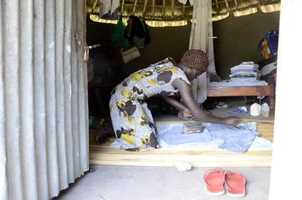 Womenpress cloths with a iron that holds hot coals