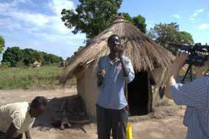 Andrew getting video in a village