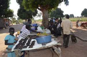 Selling mangoes and other items at market near the clinic