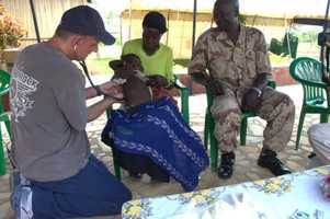 Dr. Chuck Tomek examines a child at the compound.