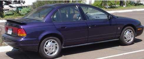 "Her first car wasa purple Saturn SL2. ""I bought it myself!"""