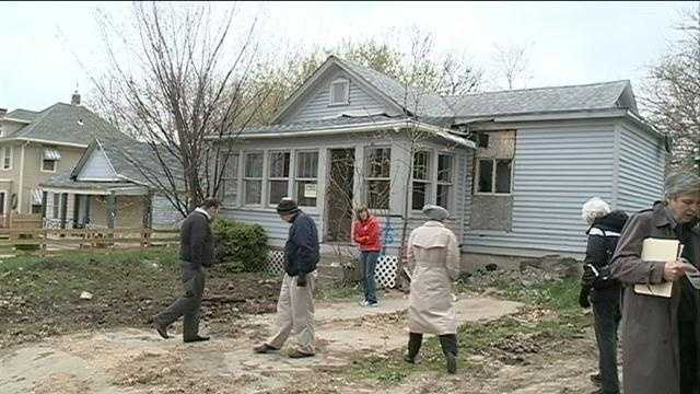 Community seeks funds for house demolitions