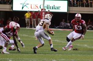 The Husker defense tries to make a tackle on a Wyoming player.