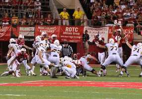 The Huskers put the pressure on Wyoming's kicker, causing him to miss a field goal.
