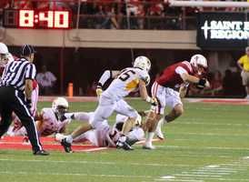 Taylor Martinez scrambles to escape a tackle.