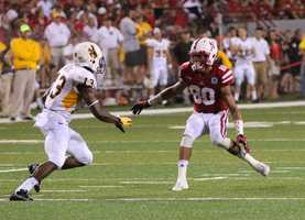 Kenny Bell uses fancy footwork to get past a Wyoming defender.