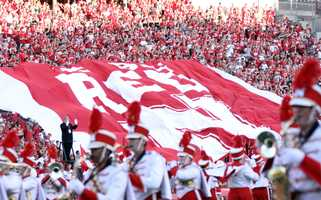 """As the band played the pregame show, the Sea of Red showed their pride with the giant """"Go Big Red"""" banner."""