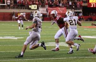 Husker David Santos closes in on the Wyoming quarterback.
