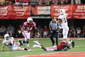 NU's Avery Moss rushes off the edge as part of a 37-34 win over Wyoming.