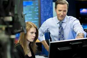 Chief meteorologist Bill Randby and meteorologist Holly McCarthy tracking storms.