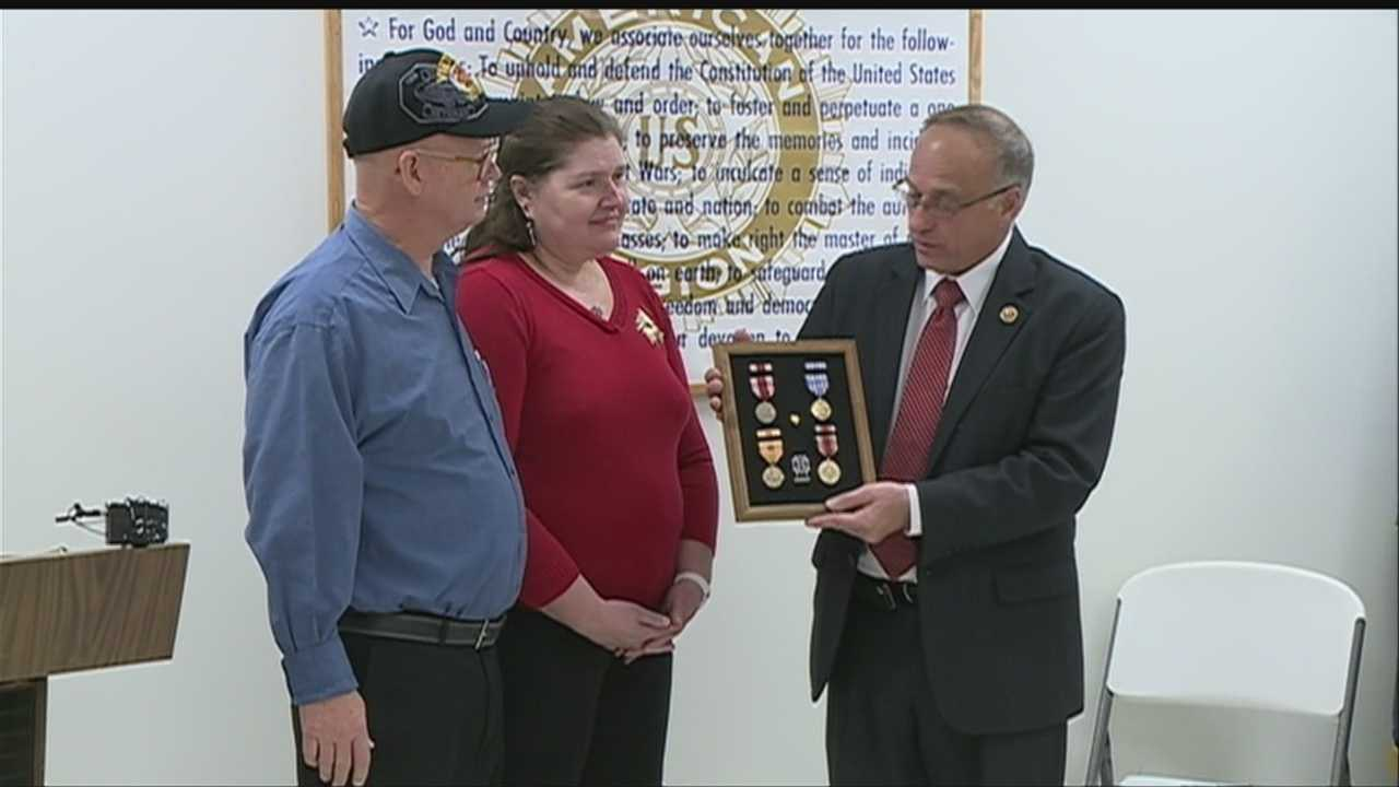 Woman takes home father's World War II medals
