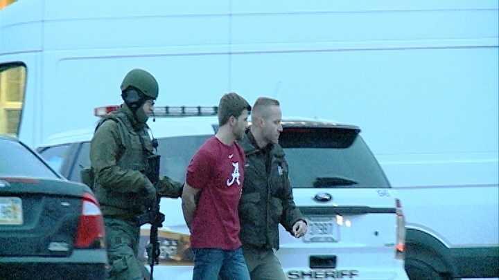 steeplechase suspect under arrest.jpg