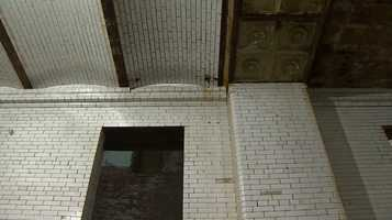 The existing subway tile on the walls and ceilings are being saved and refurbished