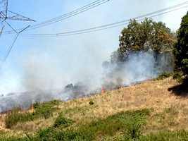 A grass fire burns on Bear Hollow Road in Sebastian County.