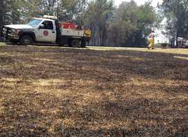 A grass fire shuts down Tennessee Ridge Road in Sebastian County.